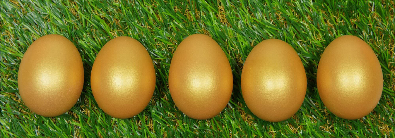Golden eggs on grass